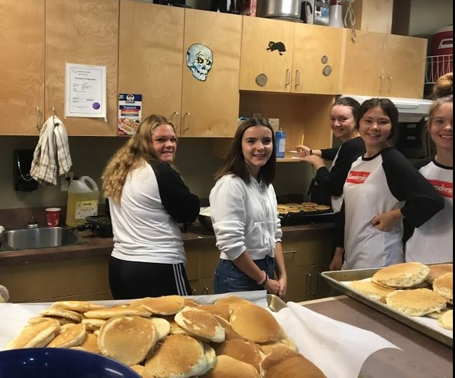 Busy Morning! WEB Leaders Make Over 1000 Pancakes to Feed Hungry Grade 7s!
